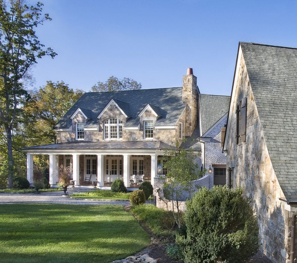 What Are Architectural Shingles with Traditional Exterior  and Arched Windows Brick Siding French Doors Lawn Outdoor Seating Porch Shingles Square Columns Stacked Stone Siding White