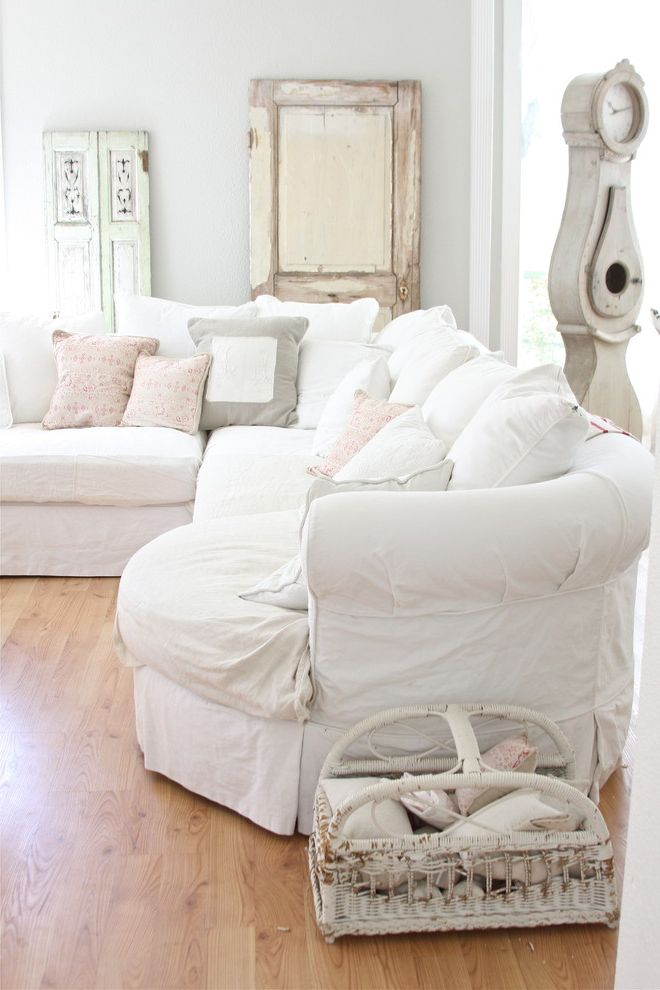 White Slip Covered Sofa   Shabby Chic Style Living Room  and Basket Flea Sofa French Grandfather Clock Hardwood Floors Parisian Shabby Chic Slipcover Throw Pillows White Wicker