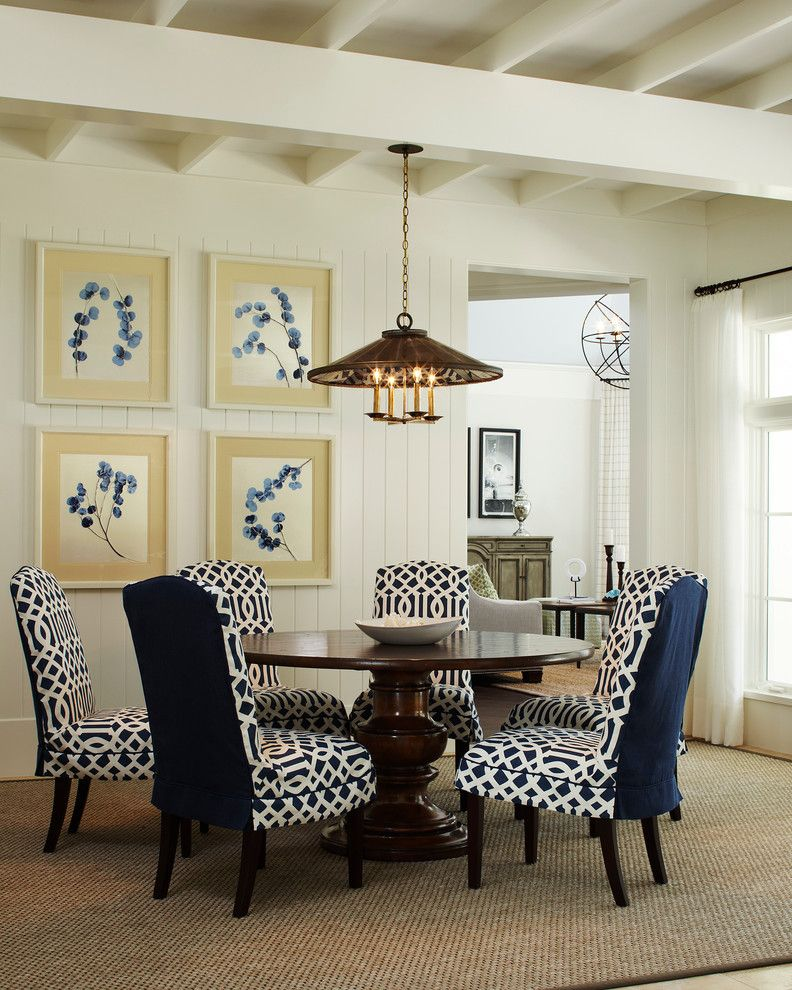 White Slip Covered Sofa   Traditional Dining Room Also Blue and White Blue and White Dining Chairs Exposed Beams Exposed Joist Jute Rug Round Dining Table Sheer White Curtains Shiplap Walls Tongue and Groove Walls White Walls