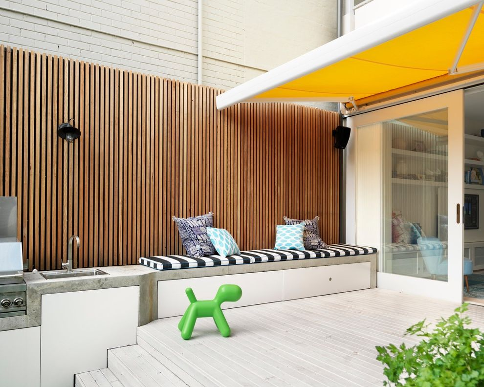 Awning in a Box   Contemporary Deck Also Accessories Bold Colours Built in Outdoor Furniture Custom Made Joinery Fence Outdoor Deck Outdoor Kitchen Outdoor Living Seat Cushions Sink Sliding Glass Doors Terrace Yellow Sunshade