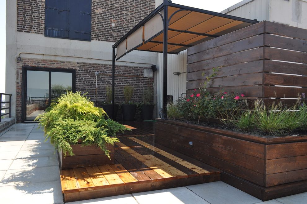 Awning in a Box with Contemporary Landscape  and Awning Beige Awning Brick Exterior Brick Siding Concrete Patio Glass Door Metal Siding Multicolored Wood Patio Outdoor Potted Plant Wood Patio Wood Planters Wood Slab Patio Wood Wall