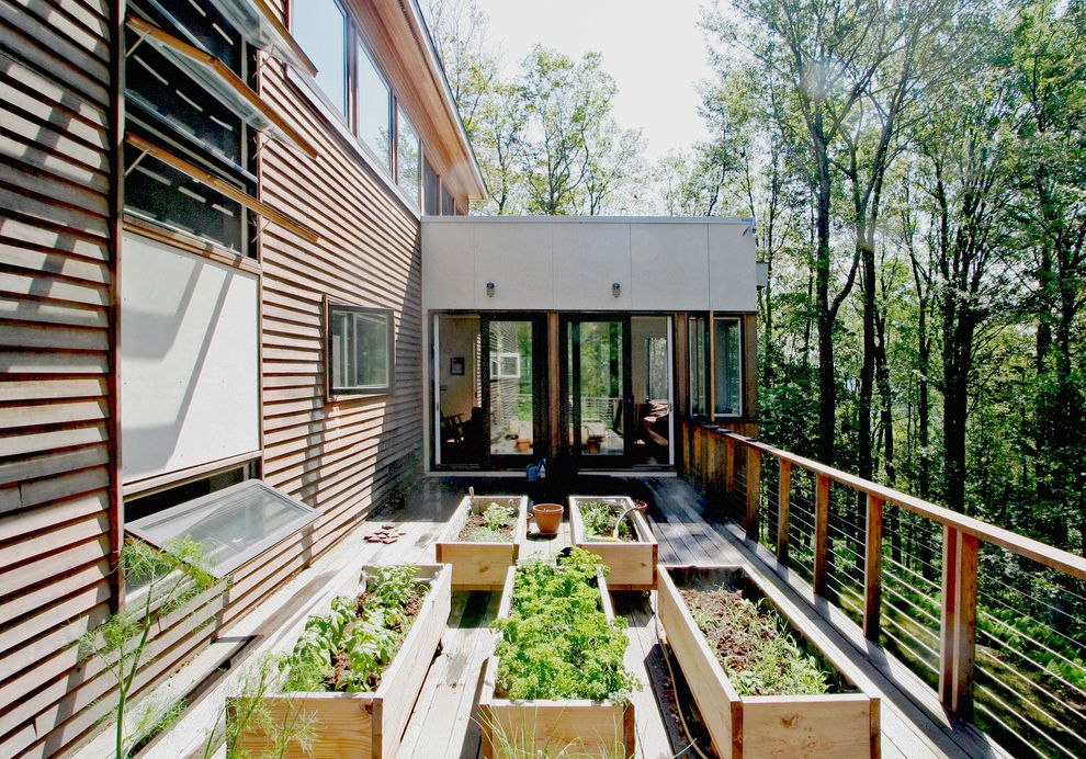 Awning in a Box with Modern Deck Also Awning Windows Backyard Cable Railing Deck Edible Gardening Raised Beds Raised Planters Wood Siding