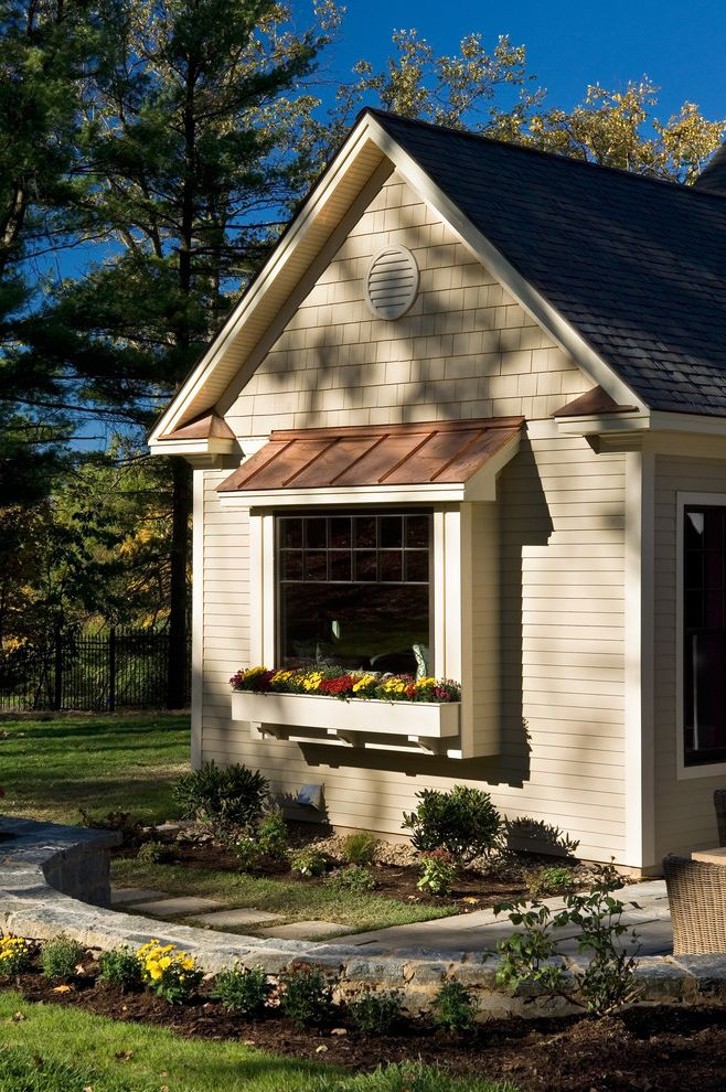 Awning in a Box with Traditional Exterior Also Grass Lawn Metal Roof Path Pavers Shingle Siding Standing Seam Roof Stone Walls Turf Walkway Window Boxes Wood Siding Wood Trim