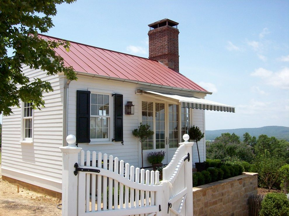 Brad Smith Roofing with Traditional Exterior Also Awning Black Shutters Charming Chimney Cottage Gate Kitchen Lantern Metal Roof Mountain View Outbuilding P Allen Smith Picket Fence Red Roof Stone Wall White House