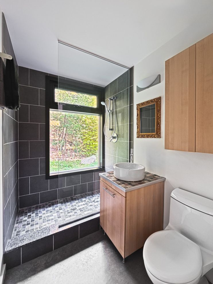 Champion Windows Omaha   Modern Bathroom  and Concrete Floor Flush Cabinets Gilt Frame Mirror Glass Panel Gray Natural Wood Round Vessel Sink Tile Counter Tile Shower Transom Window White Walls