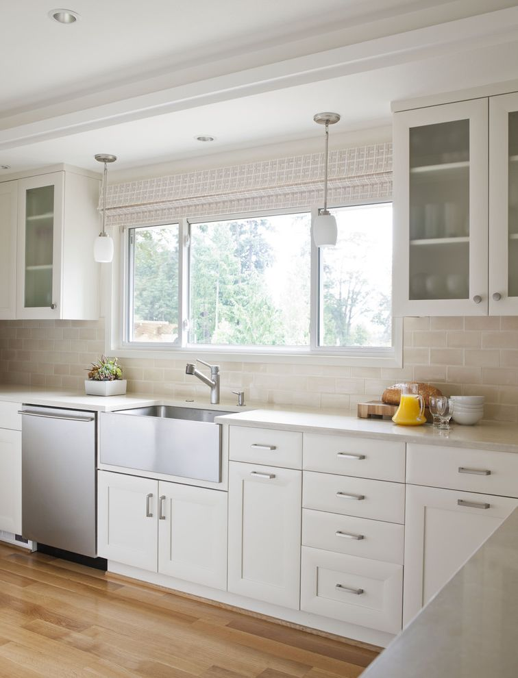 Champion Windows Omaha   Traditional Kitchen  and Farmhouse Sink Frosted Glass Frosted Glass Cabinet Pendant Light Stainless Steel Subway Tile White Cabinet White Kitchen Wood Floor
