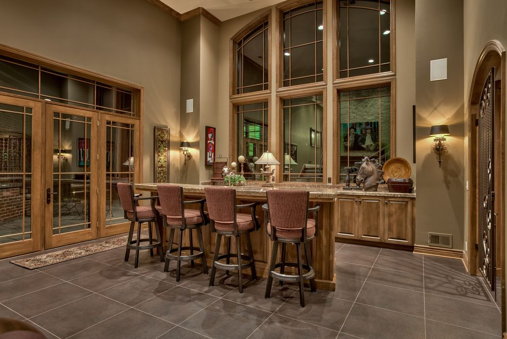 Champion Windows Omaha with Traditional Home Bar  and Arched Windows Brown Floor Tile Glass Door High Ceiling Transom Windows Upholstered Bar Stoolsl Wall Sconces