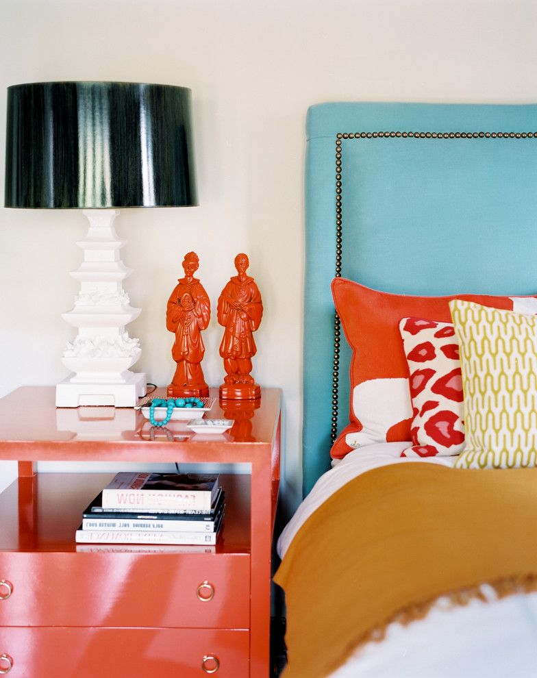 Coral Colored Throws   Eclectic Bedroom  and Accent Colors Bedside Table Bold Colors Bright Colors Decorative Pillows Nailhead Trim Nightstand Orange Sculpture Statue Table Lamp Throw Pillows Turquoise Upholstered Headboard
