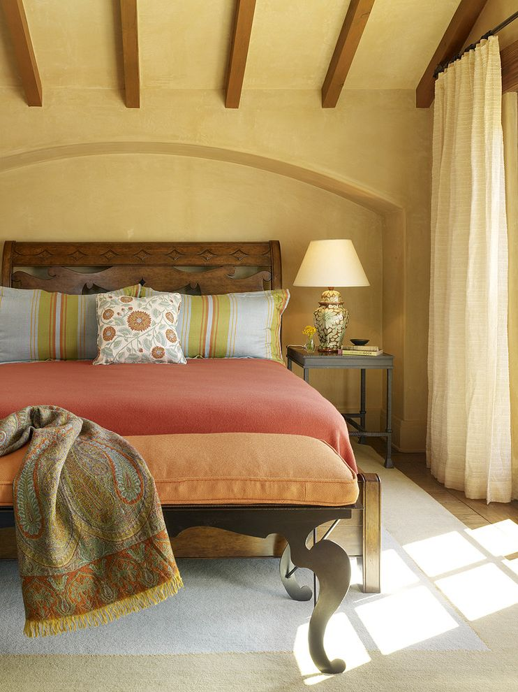 Coral Colored Throws   Mediterranean Bedroom  and Arch Wall Cutout Beige Wall Blue Accents Blue and Beige Rug Carved Wood Bed Colorful Accent Pillows Cream Curtains Mexican Style Orange Accents Orange Bedding Orange Bedroom Bench Textured Wall Wood Beams