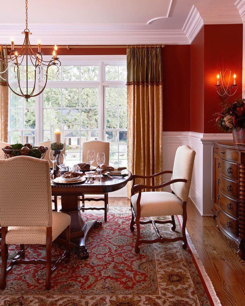 Dining Room Drapes Ideas   Traditional Dining Room Also Chandelier Crown Molding Dining Room Dining Table Drapes Dresser Red Rug Red Walls Sconce Tableware Wainscoting