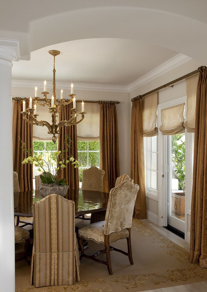 Dining Room Drapes Ideas   Traditional Dining Room  and Arched Doorway Area Rug Chandeliers Cream Custom Design Dining Room Elegant French Windows Gold White Patio Roman Shade Round Table Slipcover Traditional Window Treatment