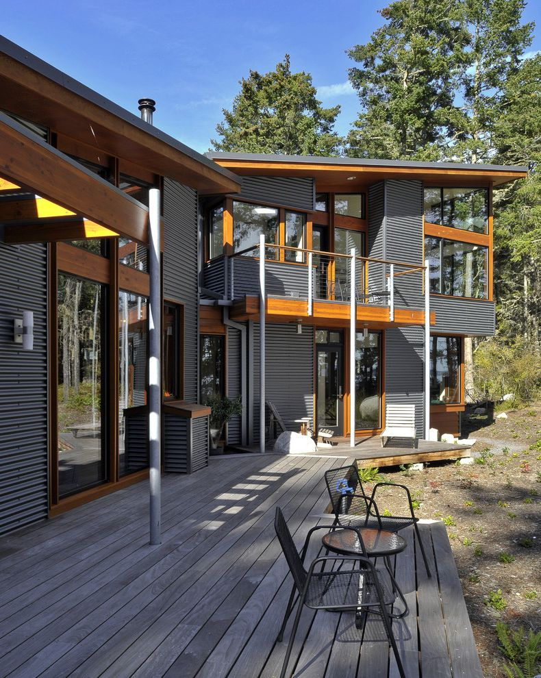 Edco Steel Siding with Contemporary Exterior Also Backyard Balcony Boulder Deck Geometric Geometry Natural Wood Overhang Pacific Northwest Pergola Rock Roofline Rural San Juan Islands Sliding Door Steel Post Steel Siding Wood Flooring Wood Trim