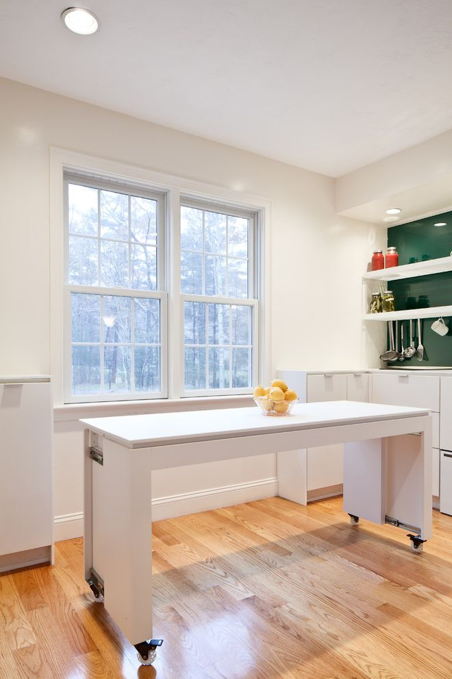 Expanding Circle Table   Contemporary Kitchen  and Casters Clean Dining Table Glass Backsplash Kitchen Storage Minimalist Kitchen Shelving Small Kitchen White Cabinets White Trim White Walls Wood Floor