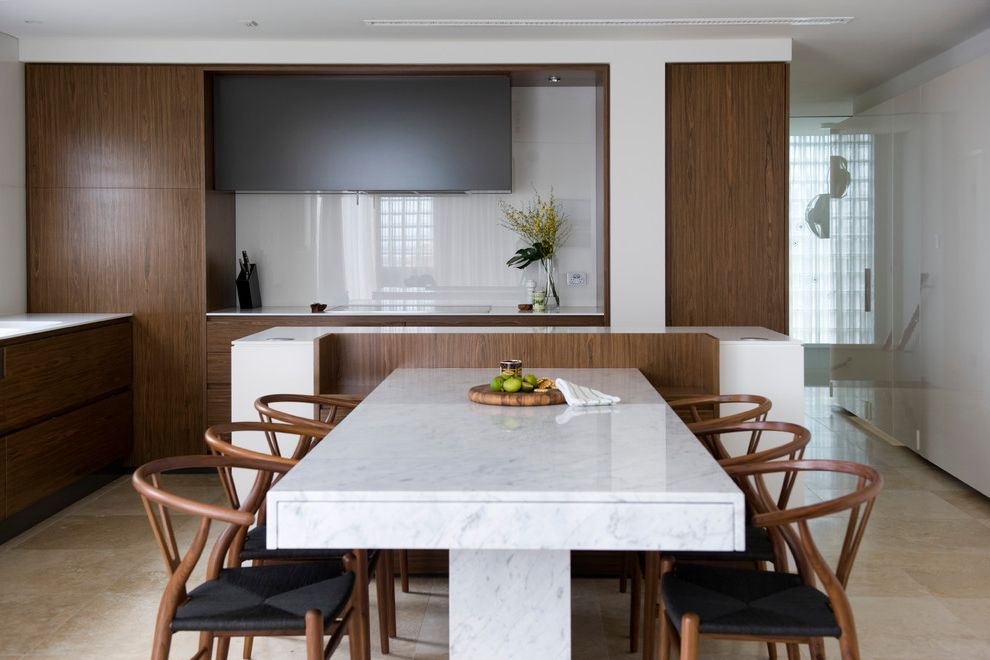 Expanding Circle Table with Contemporary Dining Room  and Beige Stone Floor Corian Countertop Custom Dining Table High Gloss Backsplash Marble Dining Table Walnut Veneer Cabinets White Countertop White Wall Wishbone Dining Chair