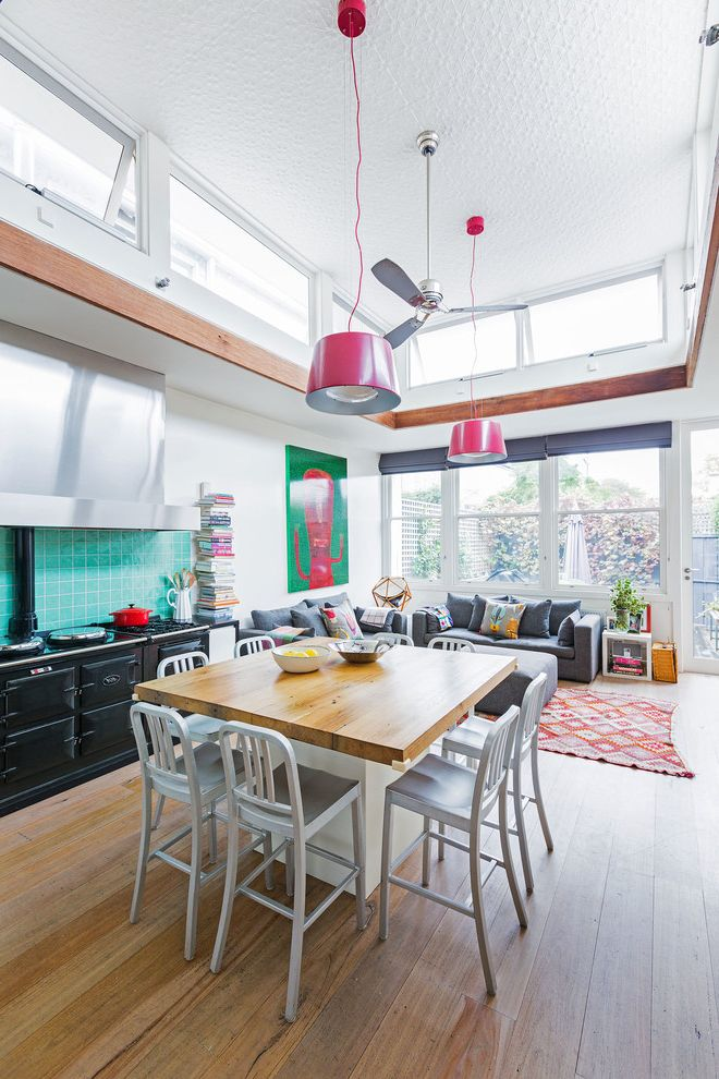 High Style Rentals   Eclectic Kitchen  and Aga Blue and Black Bright Bright Pink Pendant Lighting Bright Pink Pendant Lights Pops of Color Roman Shades Stainless Steel Hood Terrace Textured Ceiling Transom Windows White Walls
