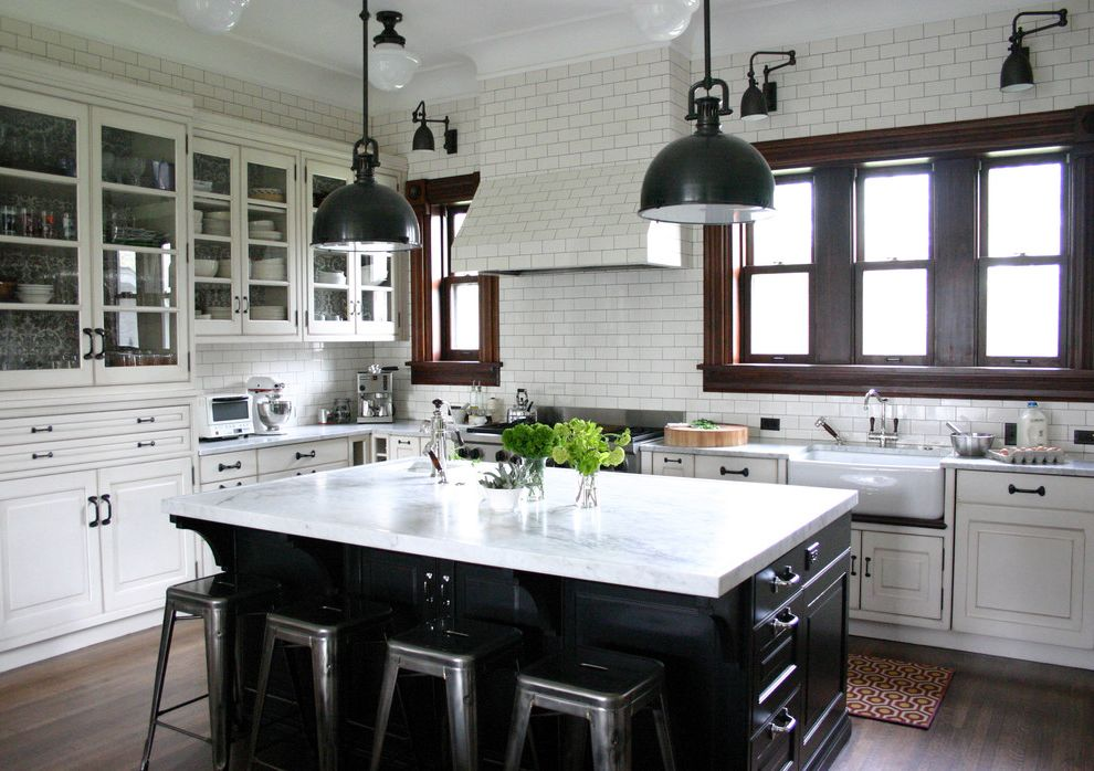 High Style Rentals   Traditional Kitchen  and Black Farmhouse Sink Glass Front Cabinets Kitchenaid Mixer Marais Stools Pendant Lights Range Hood Schoolhouse Sconces Stainless Steel Appliances Subway Tiles Swing Arm Lights White Cabinets Wood Window Frame