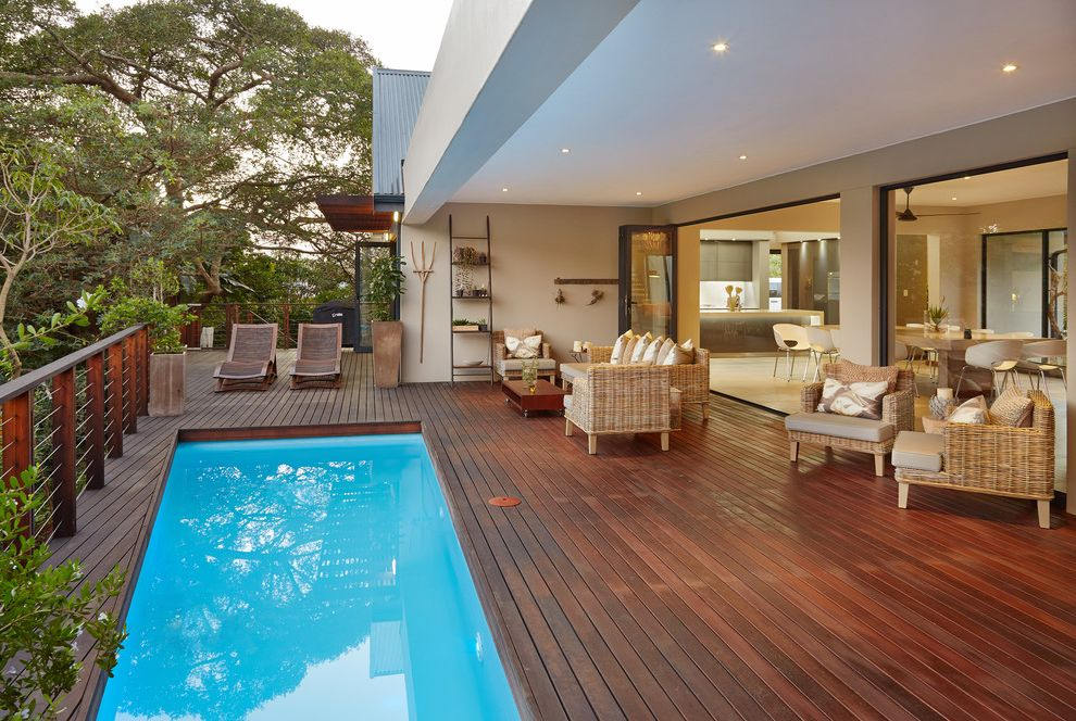 How to Build a Deck Around a Pool with Contemporary Pool Also Indooroutdoor Long Narrow Pool Metal Railing Open Space Outdoor Furniture Recessed Lighting Stucco Wood Deck Wood Lounge Chair