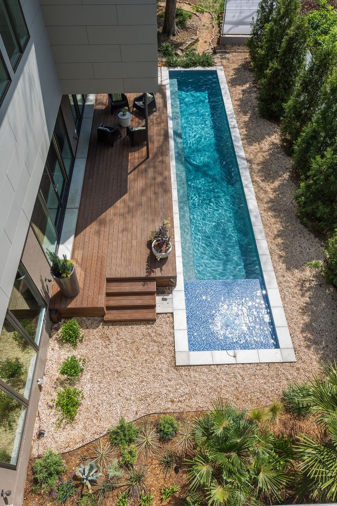 How to Build a Deck Around a Pool with Contemporary Pool  and Baja Shelf Concrete Pool Deck Covered Porch Gravel Landscaping Lap Pool Patio Potted Plants Seating Area Windows Wood Deck