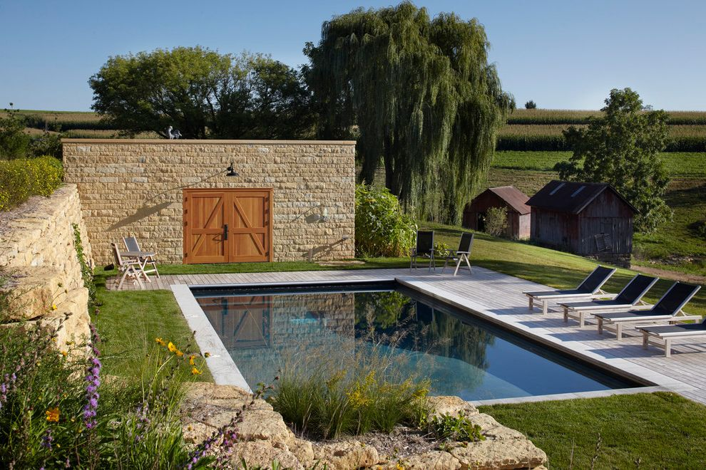 How to Build a Deck Around a Pool with Farmhouse Pool Also Chaise Lounge Deck Farm Farm House Garden Wall Grass Lawn Modern Barn Patio Furniture Poolside Planting Rustic Stone Wall Sustainable Turf
