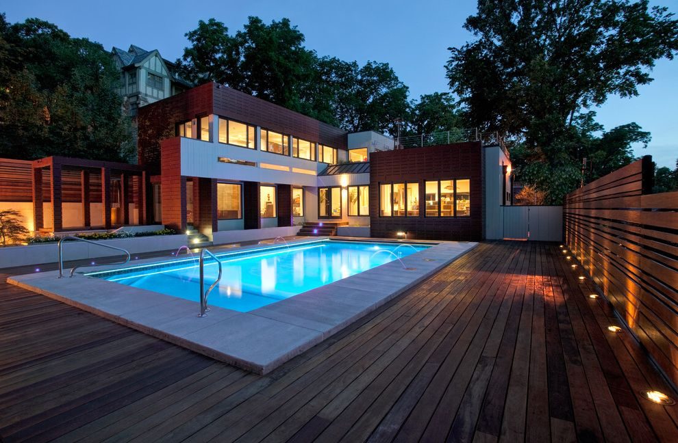 How to Build a Deck Around a Pool with Modern Pool Also Deck Flat Roof Hillside Horizontal Slat Fence Pool Lighting Roofline Sloped Step Lights Uplighting Volumes Wood Fence