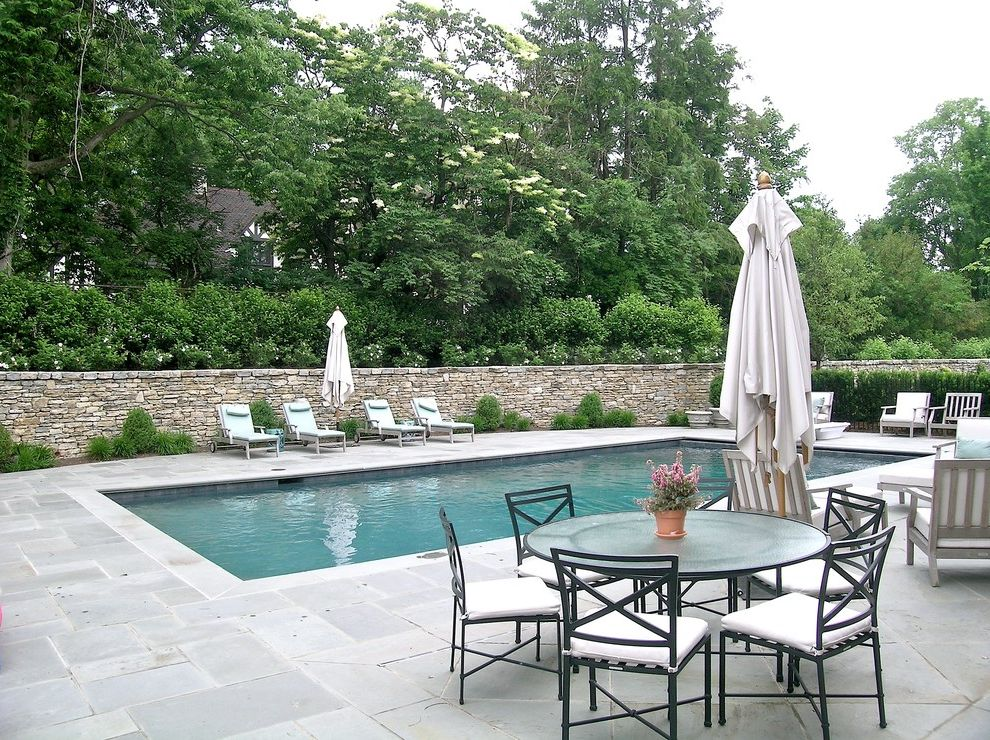 How to Build a Deck Around a Pool with Traditional Pool  and Landscaping Outdoor Dining Patio Furniture Planting Beds Pool Pool Deck Stacked Stone Wall Stone Terrace Teak Umbrella Weathered Wood