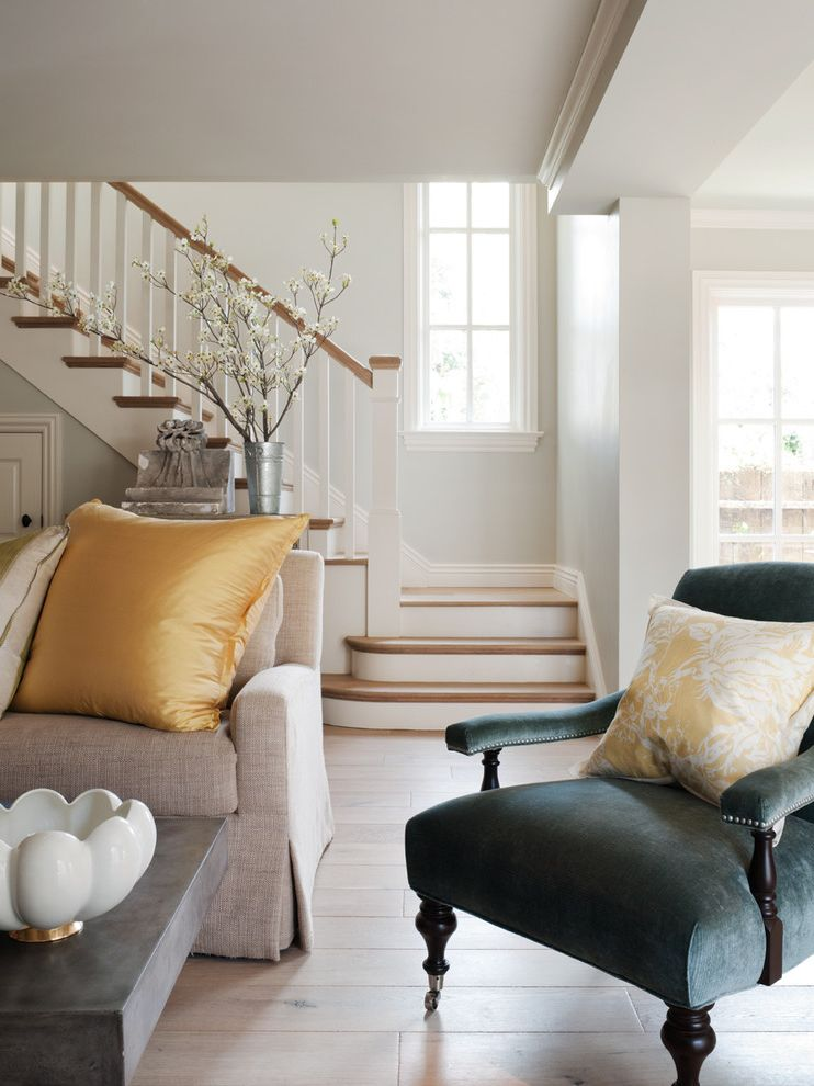 How to Move Heavy Furniture Up Stairs with Traditional Living Room  and Baseboards Blue Armchair Decorative Pillows Flowering Branches Nailhead Trim Neutral Colors Throw Pillows White Wood Wood Flooring Wood Staircase Wood Trim