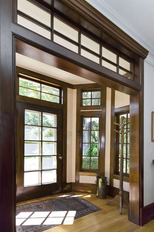 How to Stain Dark Wood Lighter with Traditional Entry Also Baseboard Carved Coat Rack Crown Molding Dark Stained Wood Dark Stained Wood Trim Entry Entry Rug Transom Window Turned White Walls Wood Floor