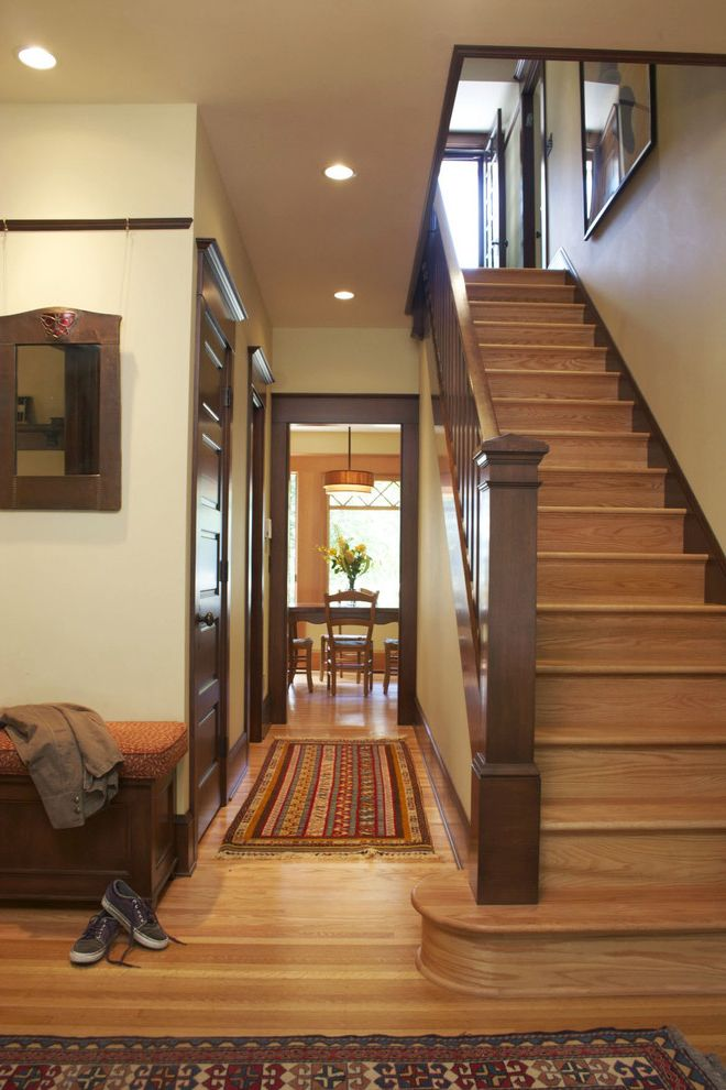 How to Stain Dark Wood Lighter with Traditional Hall Also Dark Wood Dark Wood Trim Natural Wood Rug Staircase Stairs Wood Railing Wood Stairs