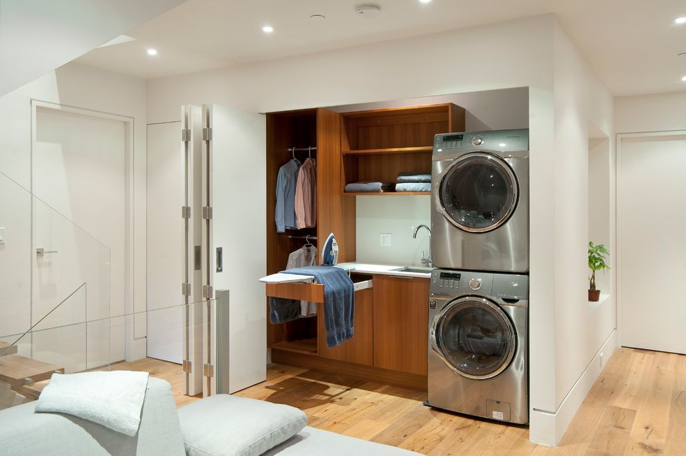 Laundry Closet Dimensions   Contemporary Laundry Room Also Bifold Doors Closet Hidden Ironing Board Pullout Quartersawn Teak Utility White Countertop