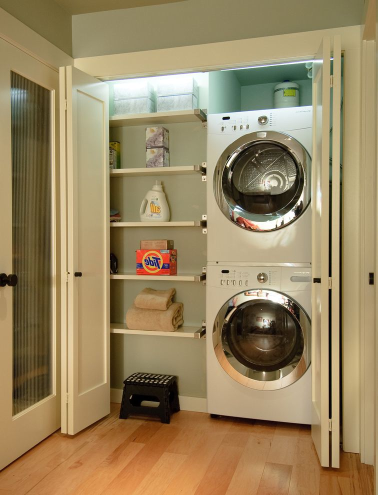 Laundry Closet Dimensions with Contemporary Laundry Room  and Clean Front Loading Washer and Dryer Green Walls Laundry Closet Organized Laundry Room Stackable Washer and Dryer Stacked Washer and Dryer Wall Shelves White Trim Wood Floors