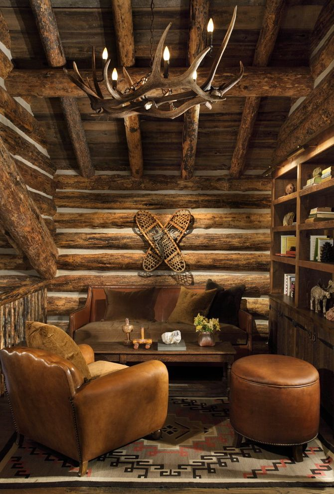 Log Cabin Builders in Texas   Rustic Family Room Also Antlers Chinking Custom Made Leather Chair Log Cabin Mountain Home Rustic Sitting Room Snow Shoes Wild West