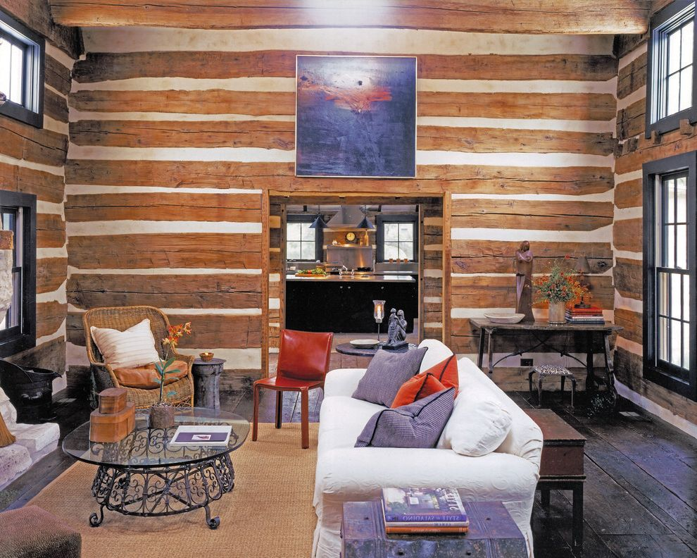 Log Cabin Builders in Texas   Rustic Family Room Also Artwork Chinking Log Home Metal Coffee Table Natural Fiber Rug Rough Hewn Wood Slipcovered Sofa Tall Ceilings Wicker Arm Chair Wide Plank Floor Wood Beams Woven Area Rug