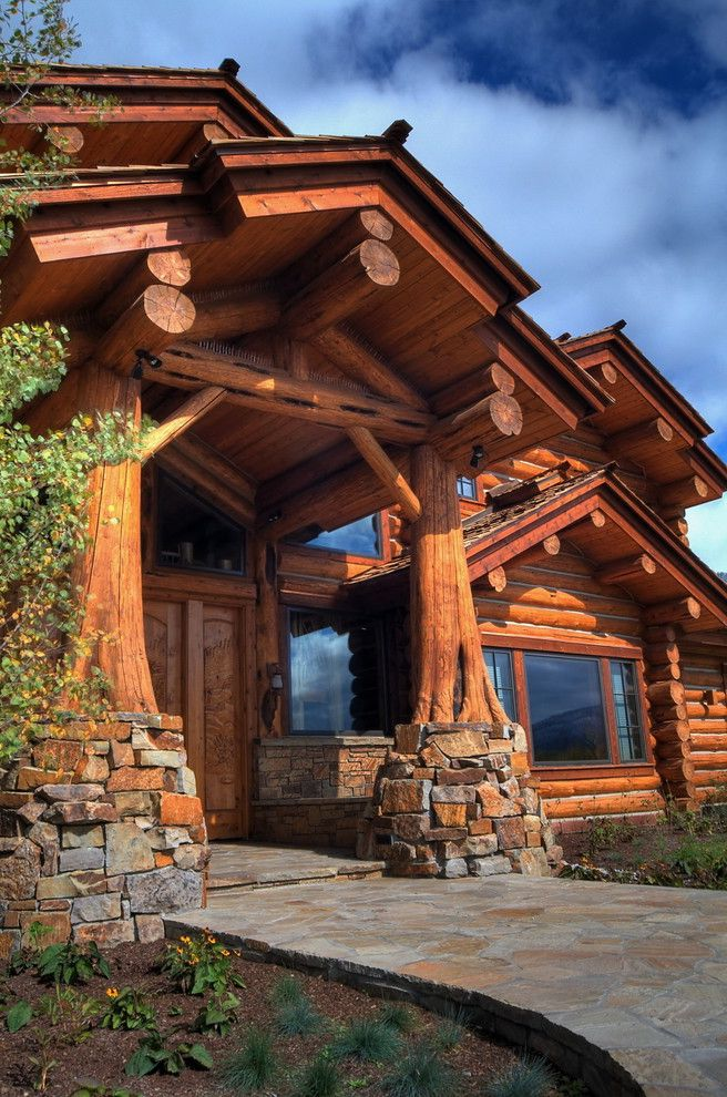 Log Cabin Builders in Texas with Rustic Entry  and Covered Entry Entry Exterior Flagstone Path Jackson Hole Log Columns Log Construction Logs Mountain Stacked Stone Stone