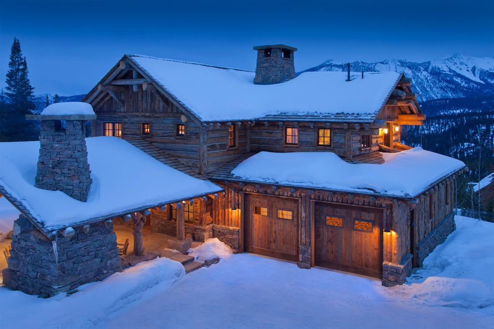 Log Cabin Builders in Texas with Rustic Exterior Also Chimney Double Garage Doors Log Cabin Mountain Home Outdoor Lighting Stacked Stone Two Story Winter Retreat
