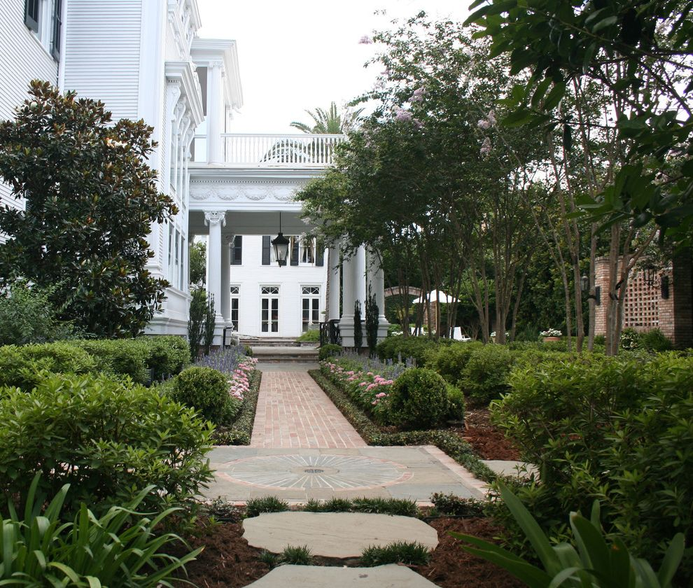 New Orleans Millworks with Traditional Landscape  and Alle Antebellum Style Brick Paving Columns Hedge Lantern Mass Plantings Outdoor Lighting Path Pavers Steps Walkway White House