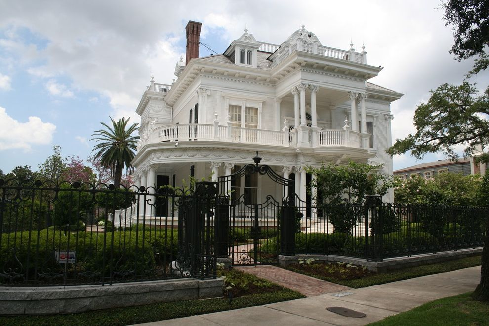 New Orleans Millworks with Victorian Exterior  and Antebellum Style Balcony Brick Paving Columns Dormer Windows Entrance Entry Entry Gate Hedge Path Roof Terrace Walkway White House Widows Walk Wrap Around Porch Wrought Iron Fence
