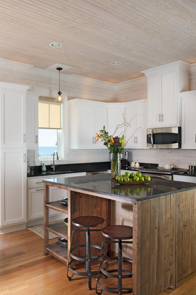 Orcas Island Cottages with Beach Style Kitchen  and Industrial Seating Pendant Light Square Island Stools