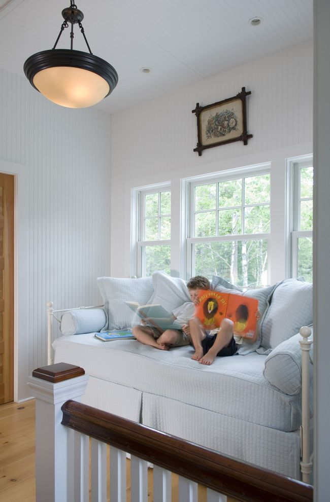 Pottery Barn Kids Park Meadows   Traditional Kids  and Cottage Living Dark Wood Railing Daybed Guest Bed Kids Maine Cottage Painted Wood Wall Paneling Stair Landing Wainscoting White and Dark Wood Railing White Sofa Window Seating Wood Wall
