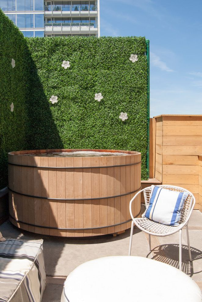 Round Wood Hot Tub   Contemporary Deck  and Hot Tub Plant Wall Privacy Screen Rooftop Stripes Wooden Hot Tub Wooden Siding Woven Chair