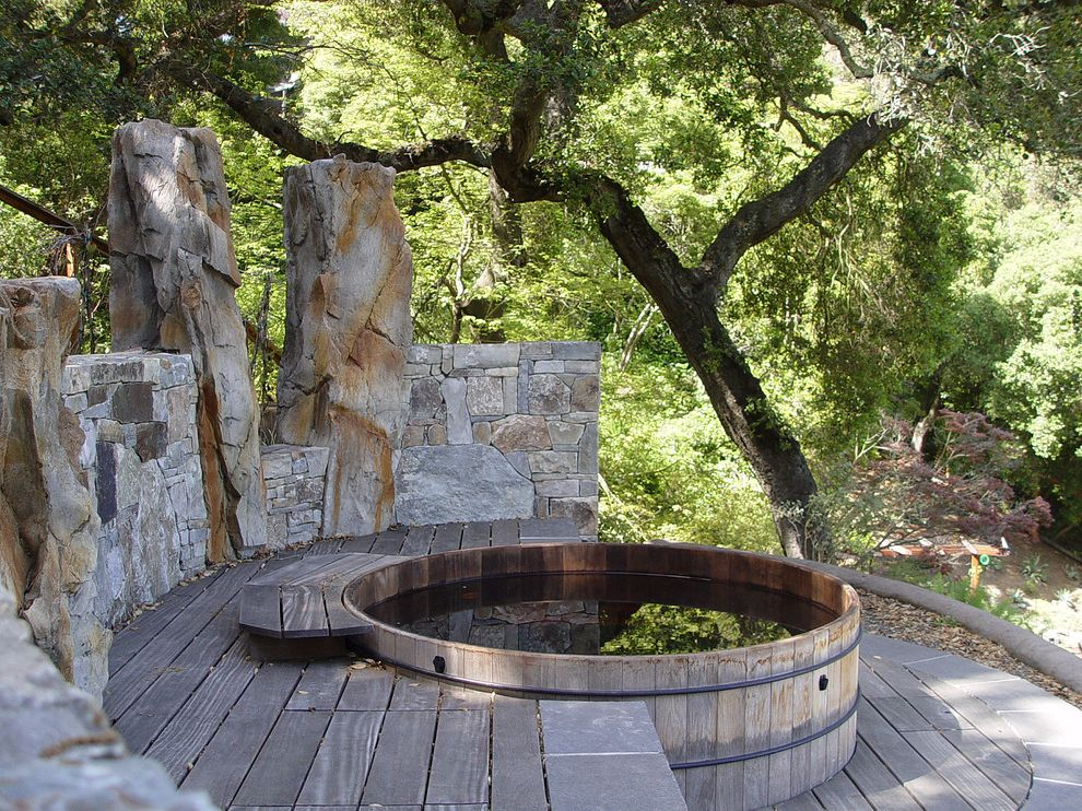 Round Wood Hot Tub with Rustic Deck  and Boulders Decks Hot Tubs Masonry Naturalistic Oak Trees Redwood Rocks Rustic Stone Stone Wall Terraced