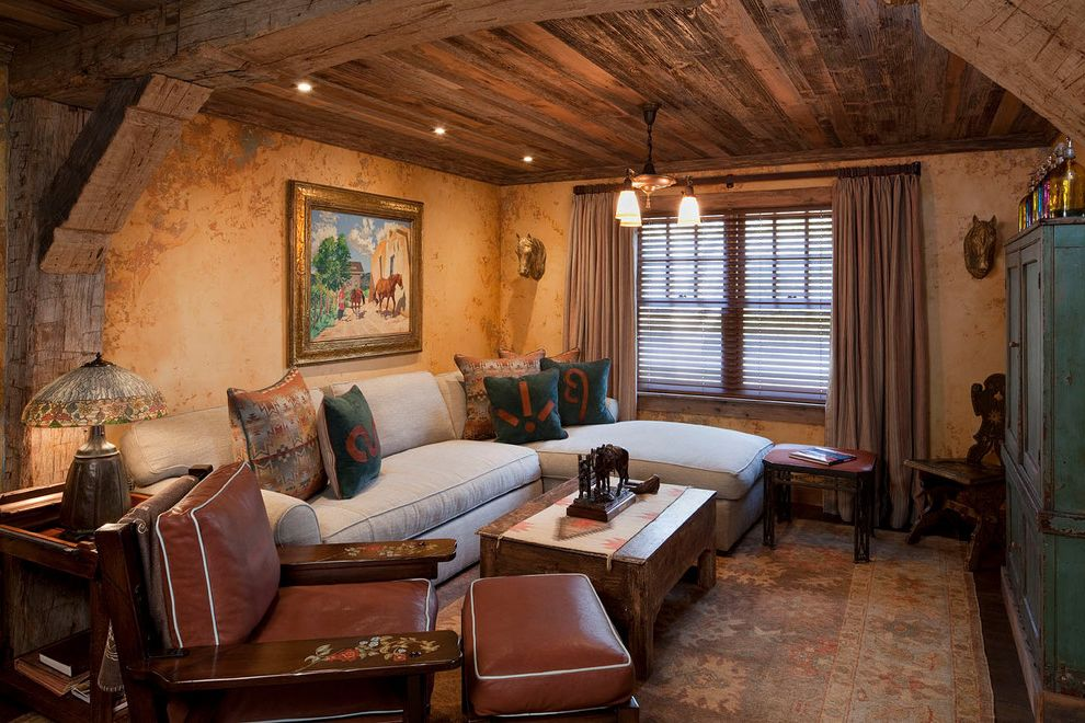 Rustic Furniture Denton Tx with Rustic Family Room Also Antiques Area Rug Chandelier Coffee Table Decorative Pillows Framed Art Leather Armchair Ottoman Reclaimed Wood Side Table Sofa Table Lamp Wood Beams Wood Ceiling