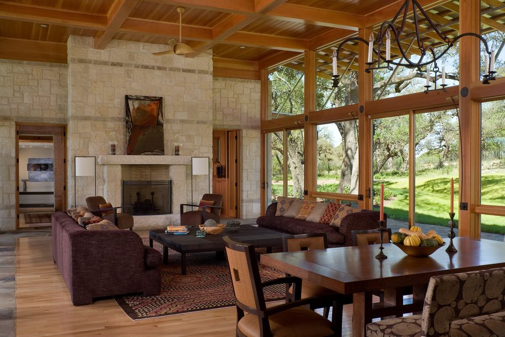 Rustic Furniture Denton Tx with Rustic Living Room Also Coffered Ceiling Contemporary Rustic Fireplace High Ceiling Open Floor Plan Rustic Modern Stained Wood Stone Chimney Stone Facade Tongue and Groove Wood Floor Wrought Iron Chandelier