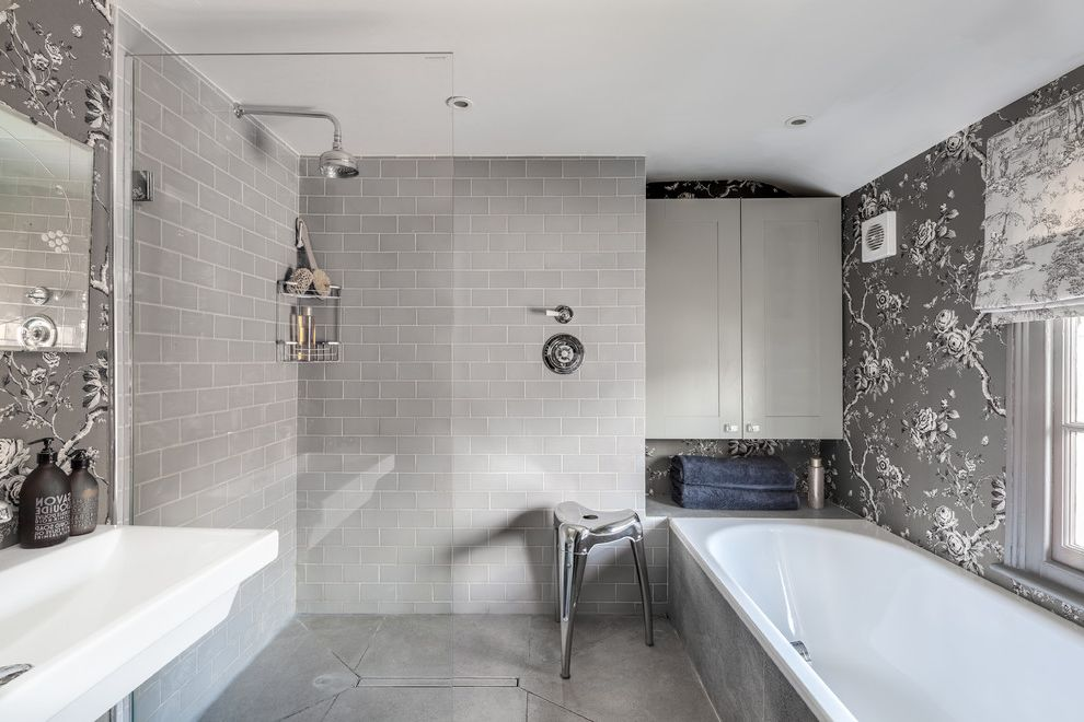 Tile Warehouse Near Me with Transitional Bathroom  and Concrete Floors Console Sink Floral Wallpaper Gray Bathroom Gray Subway Tile Gray Wallpaper Metal Stool Modern Bathroom Open Shower Step in Shower