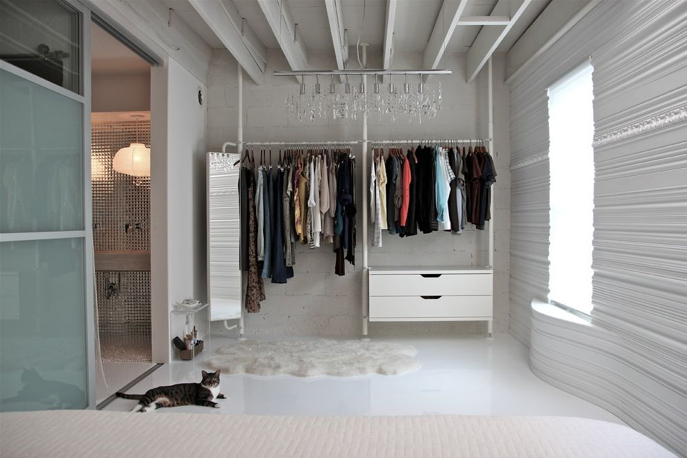 What to Do to Sell Your House   Contemporary Closet Also Cinder Block Walls Curved Walls en Suite Exposed Rafters Linear Chandelier Loft Master Bedroom Monochromatic Open Closet Sheepskin Rug Textured Walls White Bedroom White Floor