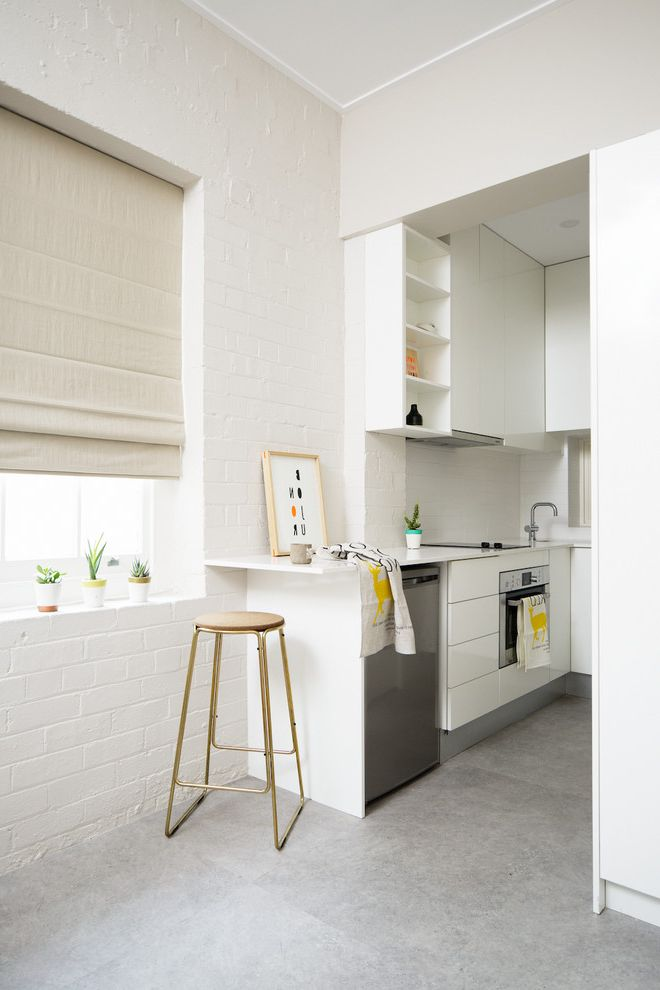 What to Use to Clean Dishwasher   Contemporary Kitchen Also Apartment Bar Stool Contemporary Decor Exposed Brick Flat Top Stove Minimal Modern Modern Kitchen Modern Kitchen Design Neutral Small Space Studio White Kitchen White Painted Brick Wall
