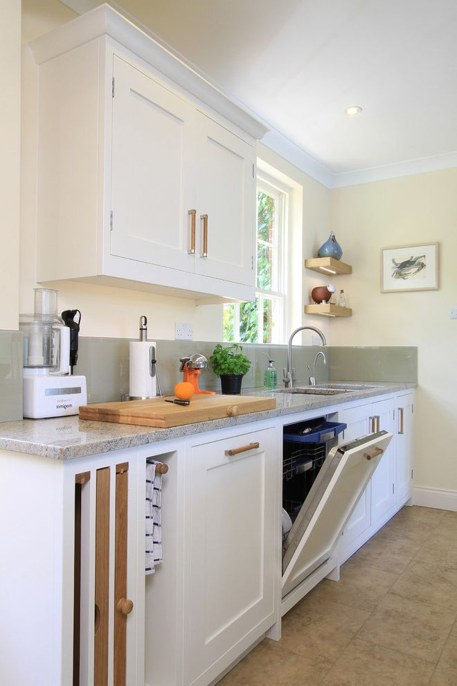 What to Use to Clean Dishwasher   Traditional Kitchen  and Chopping Block Cutting Board Floating Shelves Frame and Panel Cabinets Glass Backsplash Gray Integrated Appliances Ivory Tile Floor White Cabinets