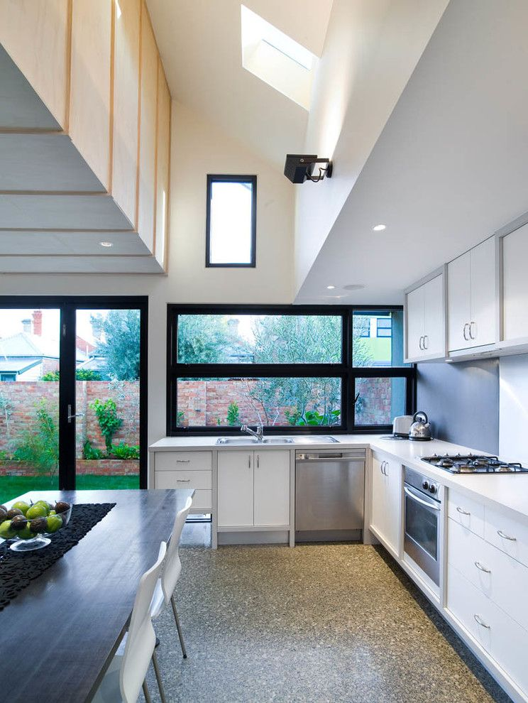 What to Use to Clean Dishwasher with Contemporary Kitchen  and Gray Floor Grey Floor High Ceiling L Shaped Kitchen Long Dining Table Recessed Lighting White Cabinets White Countertop White Dining Chairs Wood Table