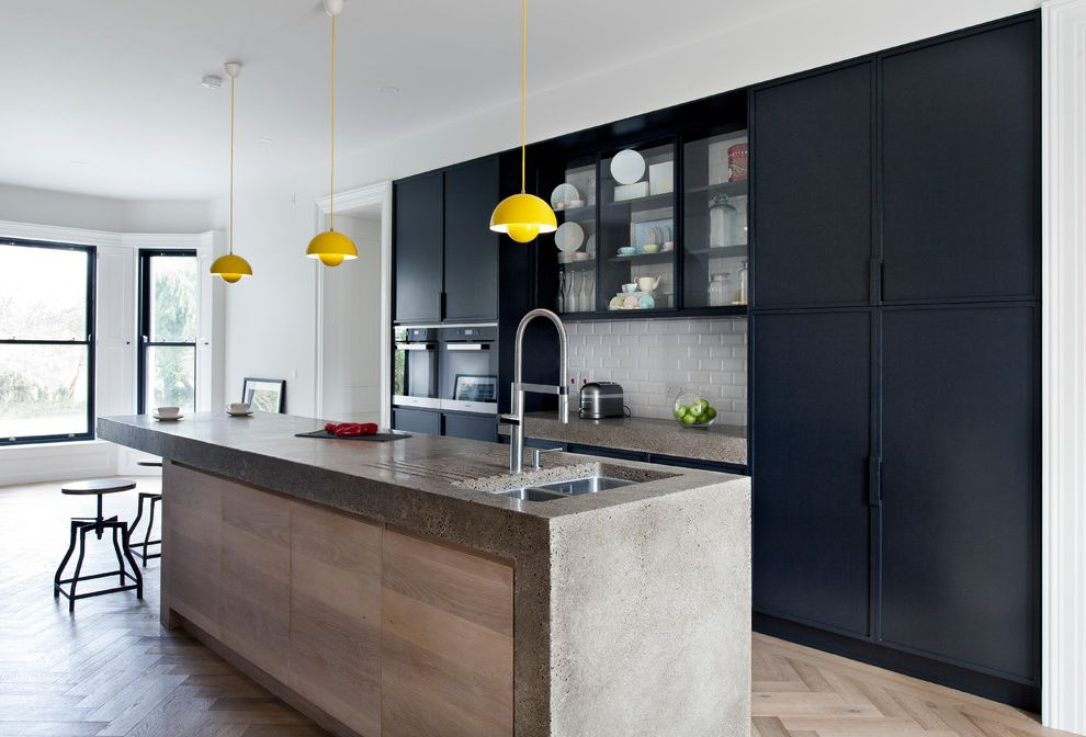 Ada Counter Height   Contemporary Kitchen  and Black and White Kitchen Black Finish Black Kitchen Granite Countertop Herringbone Pattern Stainless Steel Waterfall Counter Top White Tile White Walls Wood Panelling Yellow Pendant Lights