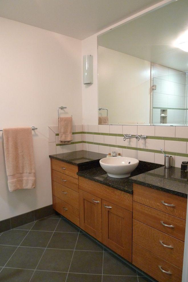 Ada Counter Height with Contemporary Bathroom  and Bathroom Hardware Dark Floor Sconce Tile Backsplash Tile Flooring Towel Bar Vessel Sink Wall Lighting Wall Mount Faucet Wood Cabinets