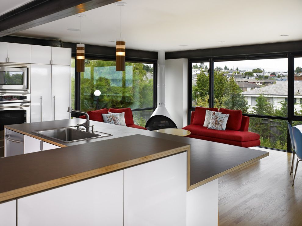 Ada Counter Height with Modern Kitchen Also Brown Counter City View Exposed Beam Glass House Indoor Outdoor Malm Modern Hardware Modern Kitchen Modern Sofa Modern Woodstove Open Floor Plan Red Sofa Steel Beam White Cabinets Wood Pendant Lights